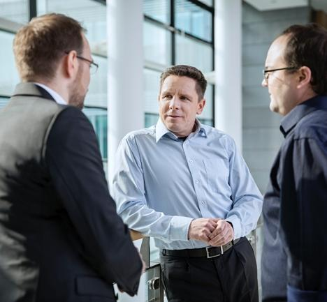 three men talking about sap